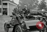 Image of Henry Ford and son, Edsel Ford pose in early model cars Dearborn Michigan USA, 1933, second 20 stock footage video 65675032016