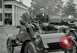 Image of Henry Ford and son, Edsel Ford pose in early model cars Dearborn Michigan USA, 1933, second 21 stock footage video 65675032016