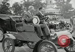 Image of Henry Ford and son, Edsel Ford pose in early model cars Dearborn Michigan USA, 1933, second 22 stock footage video 65675032016