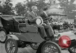 Image of Henry Ford and son, Edsel Ford pose in early model cars Dearborn Michigan USA, 1933, second 23 stock footage video 65675032016
