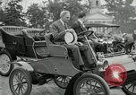 Image of Henry Ford and son, Edsel Ford pose in early model cars Dearborn Michigan USA, 1933, second 24 stock footage video 65675032016