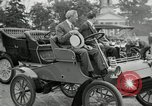 Image of Henry Ford and son, Edsel Ford pose in early model cars Dearborn Michigan USA, 1933, second 25 stock footage video 65675032016