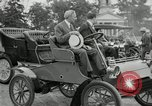Image of Henry Ford and son, Edsel Ford pose in early model cars Dearborn Michigan USA, 1933, second 26 stock footage video 65675032016