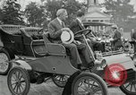 Image of Henry Ford and son, Edsel Ford pose in early model cars Dearborn Michigan USA, 1933, second 27 stock footage video 65675032016