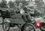 Image of Henry Ford and son, Edsel Ford pose in early model cars Dearborn Michigan USA, 1933, second 28 stock footage video 65675032016