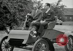 Image of Henry Ford and son, Edsel Ford pose in early model cars Dearborn Michigan USA, 1933, second 29 stock footage video 65675032016