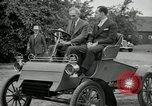 Image of Henry Ford and son, Edsel Ford pose in early model cars Dearborn Michigan USA, 1933, second 30 stock footage video 65675032016