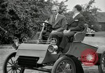 Image of Henry Ford and son, Edsel Ford pose in early model cars Dearborn Michigan USA, 1933, second 32 stock footage video 65675032016