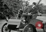 Image of Henry Ford and son, Edsel Ford pose in early model cars Dearborn Michigan USA, 1933, second 33 stock footage video 65675032016