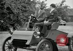 Image of Henry Ford and son, Edsel Ford pose in early model cars Dearborn Michigan USA, 1933, second 34 stock footage video 65675032016