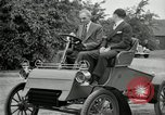Image of Henry Ford and son, Edsel Ford pose in early model cars Dearborn Michigan USA, 1933, second 35 stock footage video 65675032016