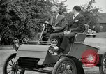 Image of Henry Ford and son, Edsel Ford pose in early model cars Dearborn Michigan USA, 1933, second 36 stock footage video 65675032016