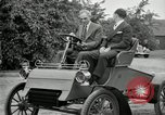 Image of Henry Ford and son, Edsel Ford pose in early model cars Dearborn Michigan USA, 1933, second 38 stock footage video 65675032016