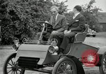 Image of Henry Ford and son, Edsel Ford pose in early model cars Dearborn Michigan USA, 1933, second 39 stock footage video 65675032016