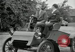 Image of Henry Ford and son, Edsel Ford pose in early model cars Dearborn Michigan USA, 1933, second 40 stock footage video 65675032016