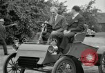 Image of Henry Ford and son, Edsel Ford pose in early model cars Dearborn Michigan USA, 1933, second 41 stock footage video 65675032016