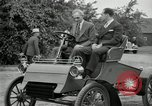 Image of Henry Ford and son, Edsel Ford pose in early model cars Dearborn Michigan USA, 1933, second 42 stock footage video 65675032016