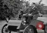Image of Henry Ford and son, Edsel Ford pose in early model cars Dearborn Michigan USA, 1933, second 43 stock footage video 65675032016