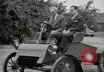 Image of Henry Ford and son, Edsel Ford pose in early model cars Dearborn Michigan USA, 1933, second 44 stock footage video 65675032016