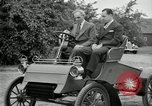 Image of Henry Ford and son, Edsel Ford pose in early model cars Dearborn Michigan USA, 1933, second 45 stock footage video 65675032016