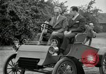 Image of Henry Ford and son, Edsel Ford pose in early model cars Dearborn Michigan USA, 1933, second 46 stock footage video 65675032016