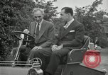 Image of Henry Ford and son, Edsel Ford pose in early model cars Dearborn Michigan USA, 1933, second 48 stock footage video 65675032016