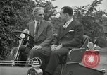 Image of Henry Ford and son, Edsel Ford pose in early model cars Dearborn Michigan USA, 1933, second 49 stock footage video 65675032016