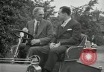 Image of Henry Ford and son, Edsel Ford pose in early model cars Dearborn Michigan USA, 1933, second 50 stock footage video 65675032016