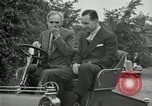 Image of Henry Ford and son, Edsel Ford pose in early model cars Dearborn Michigan USA, 1933, second 51 stock footage video 65675032016