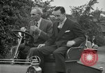 Image of Henry Ford and son, Edsel Ford pose in early model cars Dearborn Michigan USA, 1933, second 52 stock footage video 65675032016