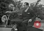 Image of Henry Ford and son, Edsel Ford pose in early model cars Dearborn Michigan USA, 1933, second 53 stock footage video 65675032016