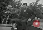 Image of Henry Ford and son, Edsel Ford pose in early model cars Dearborn Michigan USA, 1933, second 54 stock footage video 65675032016