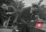 Image of Henry Ford and son, Edsel Ford pose in early model cars Dearborn Michigan USA, 1933, second 55 stock footage video 65675032016