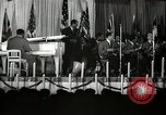 Image of Count Basie and Orchestra at Paul Robeson birthday party New York City USA, 1944, second 20 stock footage video 65675032041