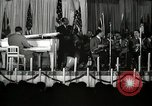 Image of Count Basie and Orchestra at Paul Robeson birthday party New York City USA, 1944, second 22 stock footage video 65675032041