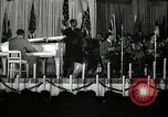 Image of Count Basie and Orchestra at Paul Robeson birthday party New York City USA, 1944, second 23 stock footage video 65675032041