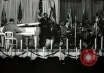 Image of Count Basie and Orchestra at Paul Robeson birthday party New York City USA, 1944, second 25 stock footage video 65675032041