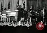 Image of Count Basie and Orchestra at Paul Robeson birthday party New York City USA, 1944, second 33 stock footage video 65675032041