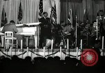 Image of Count Basie and Orchestra at Paul Robeson birthday party New York City USA, 1944, second 36 stock footage video 65675032041