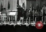 Image of Count Basie and Orchestra at Paul Robeson birthday party New York City USA, 1944, second 49 stock footage video 65675032041