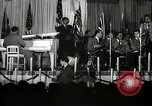 Image of Count Basie and Orchestra at Paul Robeson birthday party New York City USA, 1944, second 51 stock footage video 65675032041