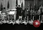 Image of Count Basie and Orchestra at Paul Robeson birthday party New York City USA, 1944, second 56 stock footage video 65675032041
