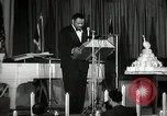 Image of Paul Robeson at his 46th birthday party New York City USA, 1944, second 24 stock footage video 65675032045