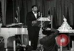 Image of Paul Robeson at his 46th birthday party New York City USA, 1944, second 39 stock footage video 65675032045