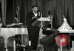 Image of Paul Robeson at his 46th birthday party New York City USA, 1944, second 41 stock footage video 65675032045