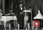 Image of Paul Robeson at his 46th birthday party New York City USA, 1944, second 58 stock footage video 65675032045