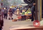 Image of people and buildings in New York city New York City USA, 1976, second 10 stock footage video 65675032059