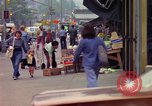 Image of people and buildings in New York city New York City USA, 1976, second 23 stock footage video 65675032059