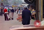 Image of people and buildings in New York city New York City USA, 1976, second 44 stock footage video 65675032059