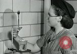 Image of women workers United States USA, 1942, second 15 stock footage video 65675032088